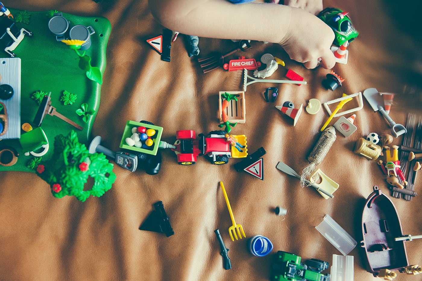 Child building with a pile of block toys
