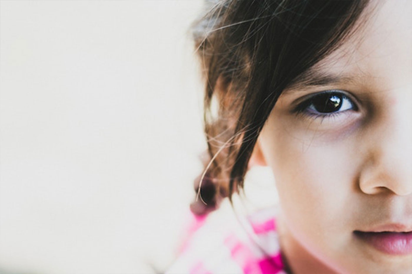 Close-up shot of a young girl looking into the camera